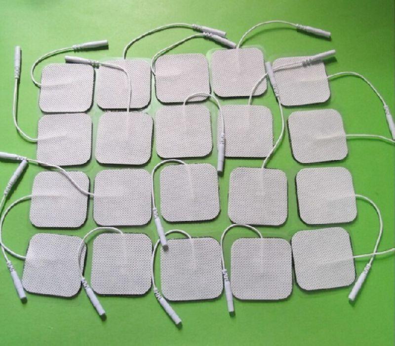 50 unids/lote, almohadillas de electrodo de repuesto para máquina Tens con cable...