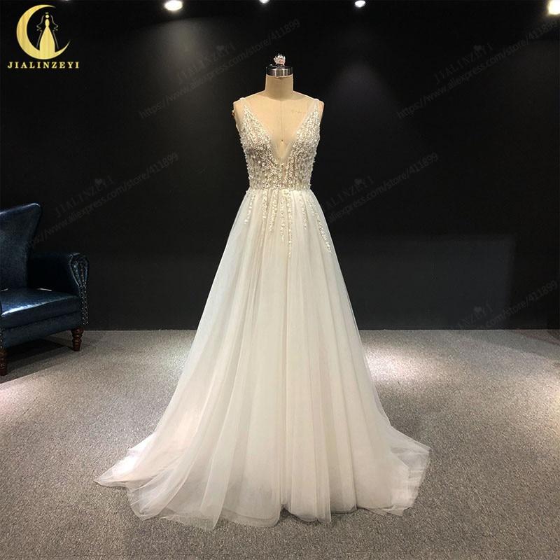 2019 Rhine Sexy Deep cuello pico lentejuelas y cristal Slit tul V back Fashion recién llegado foto Real vestidos de boda