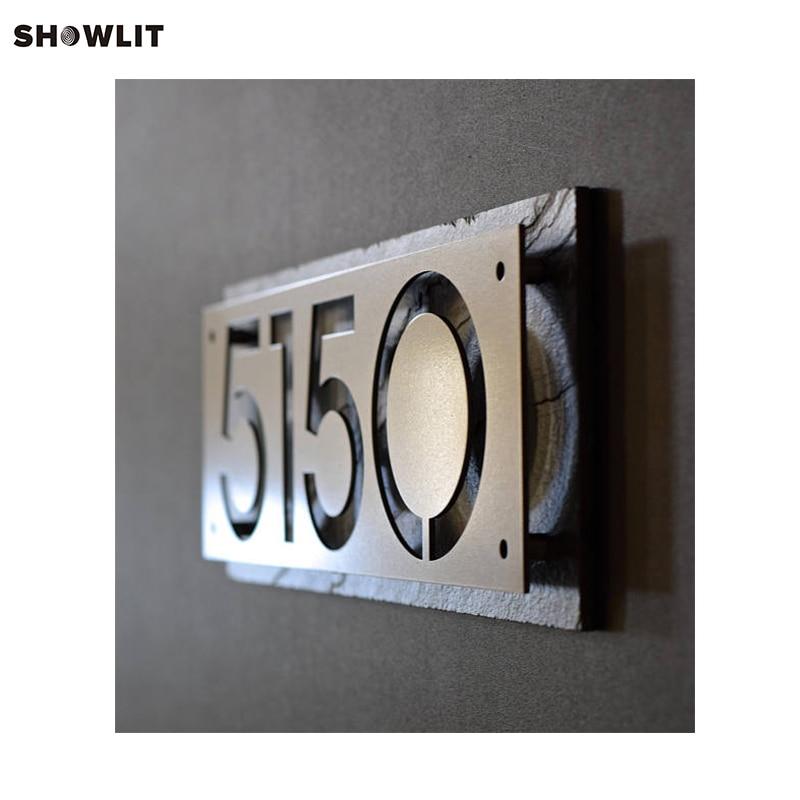 La placa de acero números de casa