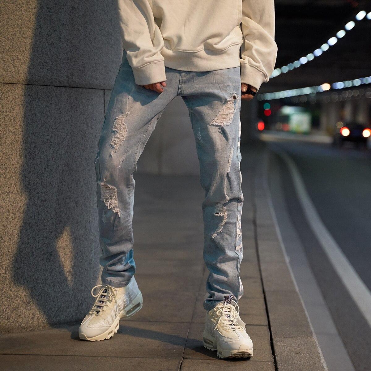Pantalones vaqueros de moda para hombre, pantalones vaqueros desgastados con estilo azul para correr, pantalones vaqueros desgastados con lavado nostálgico, pantalones vaqueros flacos de hombre destruidos