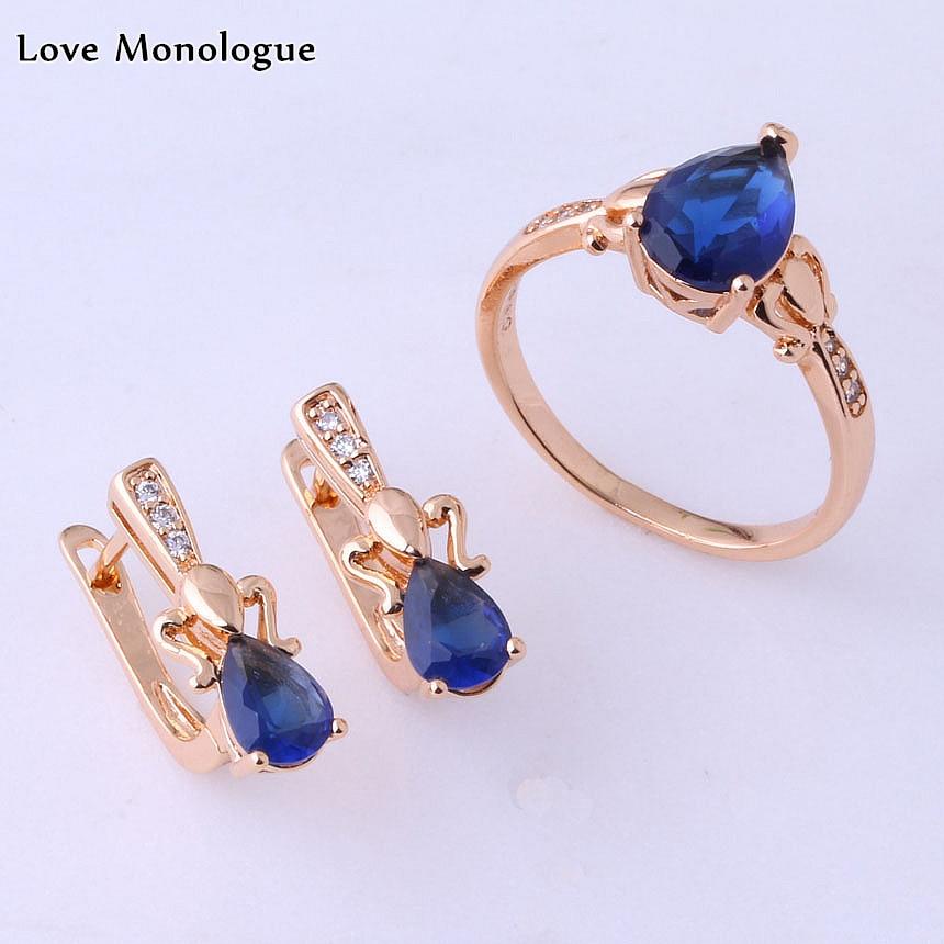Anillo de color dorado con circonita cúbica de cristal de cielo azul de alta calidad de Monologue Love y pendientes de tuerca conjuntos de joyas de gota de agua X0223