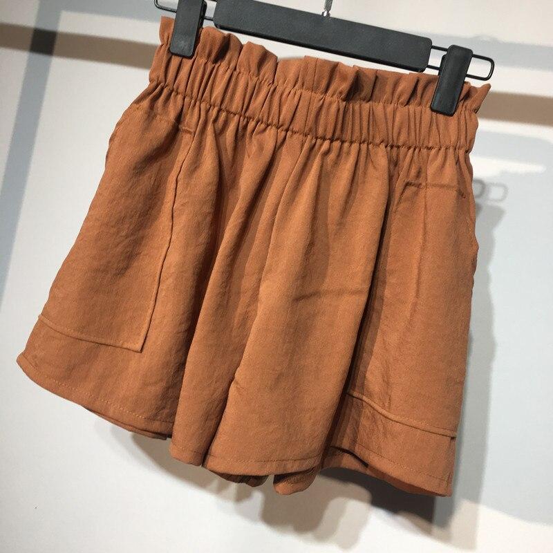 Pantalones cortos de seda helada de cintura alta de verano coreanos para mujer con bolsillo 2019, pantalones cortos blancos holgados de pierna ancha de estilo pijo, pantalones cortos de pisapapeles para mujer