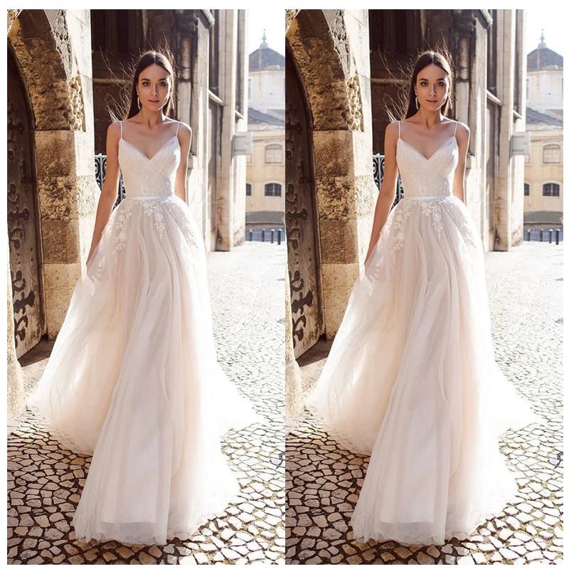 Купить с кэшбэком LORIE A Line Organza Wedding Dress 2019 Vestido De Noiva Princess Bridal Dress  Backless Spaghetti Straps Beach Wedding Dresses