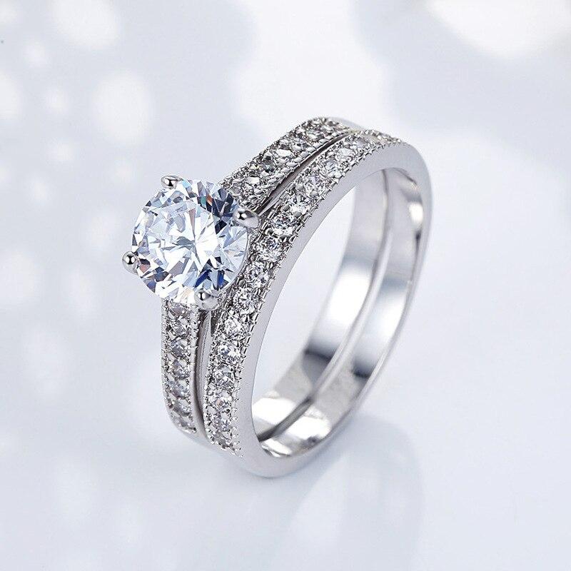 Anillo de boda clásico Huitan, anillo de compromiso tradicional con piedra de cristal brillante chapada en plata, anillo de novia para mujer