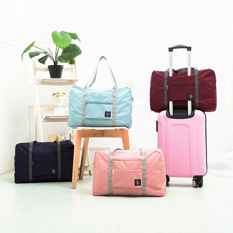 1PC nuevo alta calidad 4 colores sólido plegable de talla grande de equipaje de viaje bolsas de almacenamiento para el hogar de la Organización