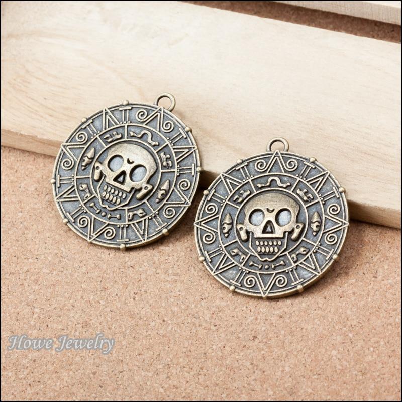 2 uds. Antiguo bronce Piratas del Caribe oro una brújula encantos cráneo ajuste DIY moda pulsera joyería accesorios A067