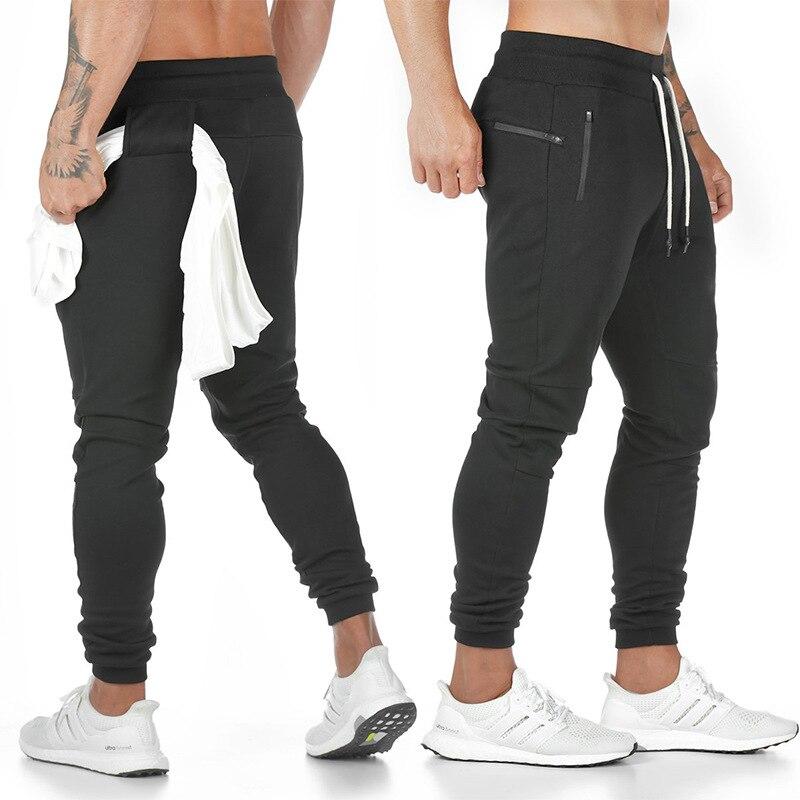 Nuevos pantalones de chándal de algodón para hombre con toallero y bolsillo para teléfono móvil pantalones ajustados para correr calzas deportivas entrenamiento para hombres