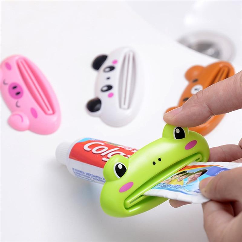 9 cm x 4.5 cm Home Tube Squeezer Easy Cartoon Toothpaste Dispenser Rolling Holder toothbrush holder kitchen Bathroom Accessories