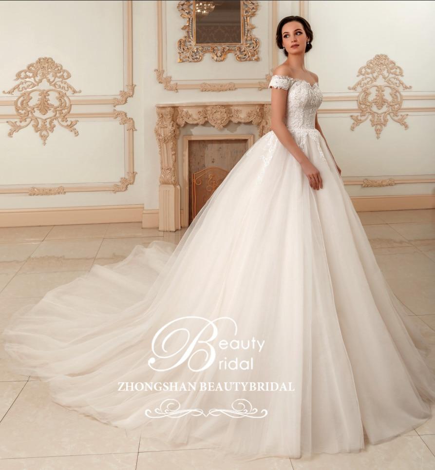 فستان زفاف 2019 vestido de noiva ثوب زفاف دانتيل وخرز مع زهور مطرز مثير Beautybridal جودة قطار XF17113