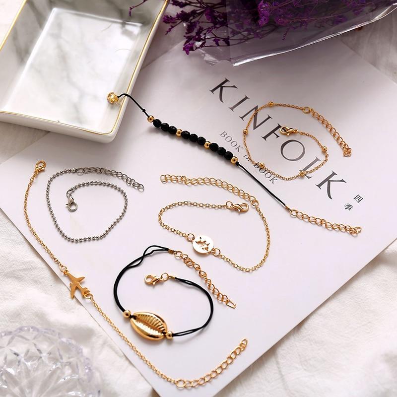 Купить с кэшбэком New Bohemian Beach bracelets Set For women Cowrie Shell aircraft metal map charm beads chains 2019 Fashion Wedding Jewelry