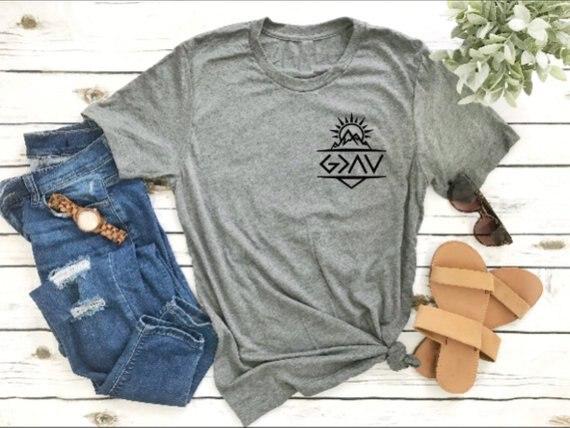 Deus é maior do que os altos e baixos gráfico camiseta bolso religião cristão bonito t estética cinza menina roupas topos