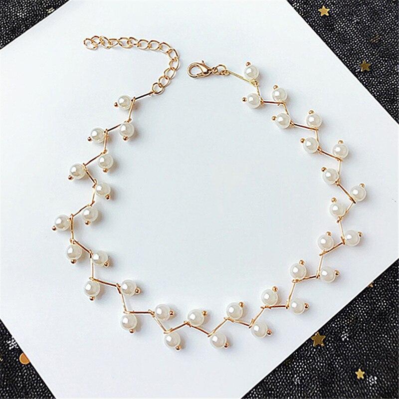 Collar de cadena de clavícula de moda femenina de marea cruzada de perlas elegante creativo de tejido de personaje geométrico