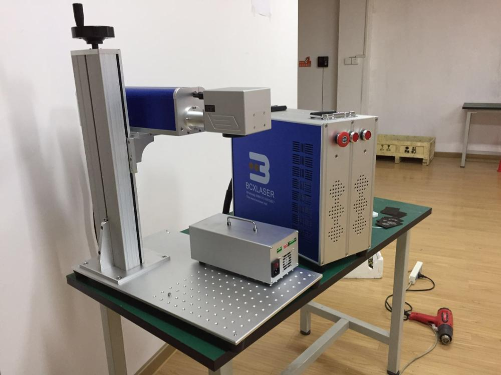 Machine de marquage laser à fibres 20 W/30 W de bonne qualité facile à utiliser pour outils de quincaillerie, couteau, lunettes, horloge