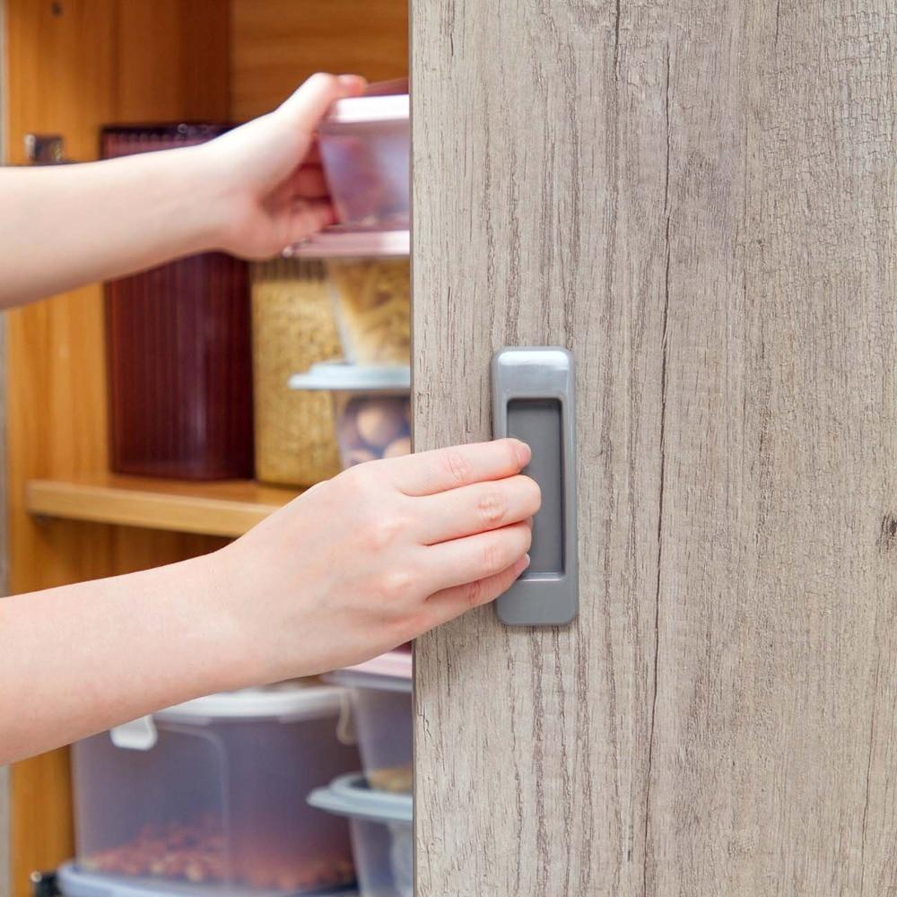 2 unids/lote pegajoso manijas de puerta para puertas interiores puertas escaparate armario cajón armario auto-adhesivo de la casa de seguridad en la puerta de la manija