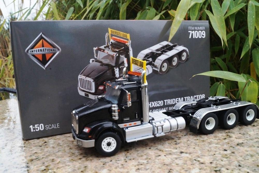 International 150 scale HX620 Black Tridem Tractor - By Diecast Masters 71009