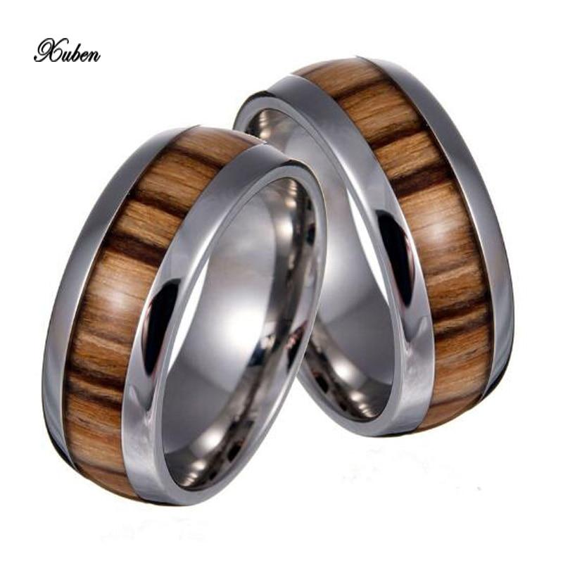 Xuben anillo de acero de titanio Europa y los Estados Unidos con incrustaciones de grano de madera anillo de cola de moda modelos de explosión para las mujeres