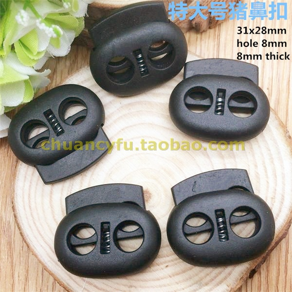 Free shipping 30 pcs/lot Black color cord lock cord stopper spring stopper garment/bag accessories