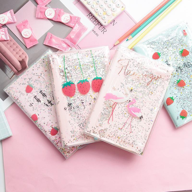 Cuaderno de memoria rosa para estudiante con diseño de corazón y arena movediza en aceite