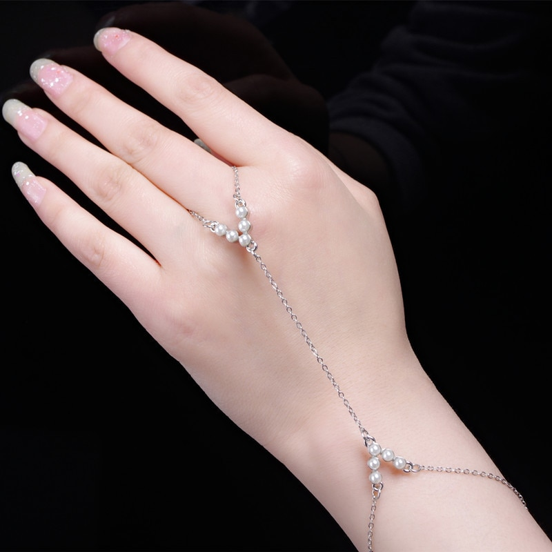 Venda quente nova moda v-forma inserir pérolas conectar ao dedo sobre pulseira para mulher