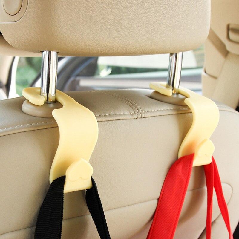 Gancho trasero para asiento de coche 1/2/4 Uds gancho reposacabezas automático gancho de gravedad soporte de suspensión Mini gancho trasero en forma de corazón Universal creativo