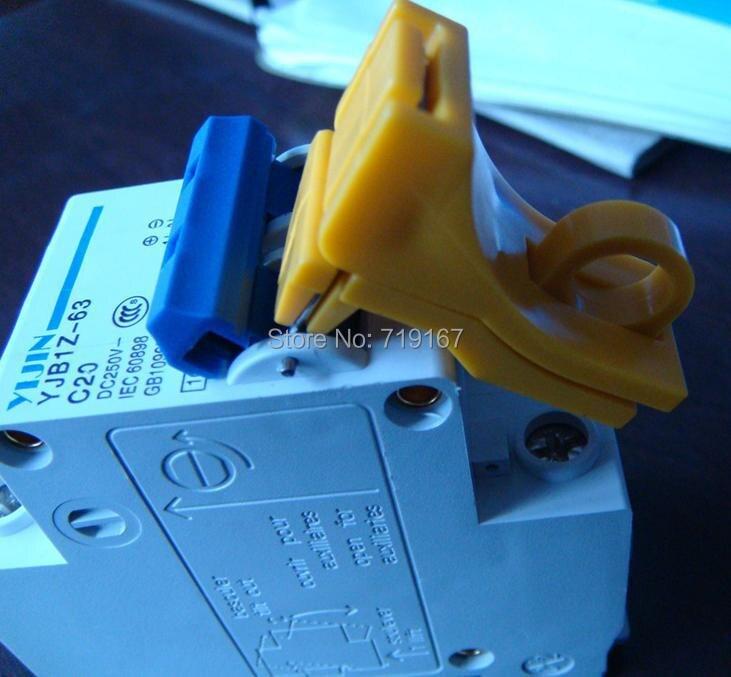 العالمي قفل الكلاب ، قاطع الدائرة قفل ، الشمسية نظام قفل الكلب ، البسيطة E-قفل البلاستيك قواطع قفل 100 قطعة إسقاط مجانا
