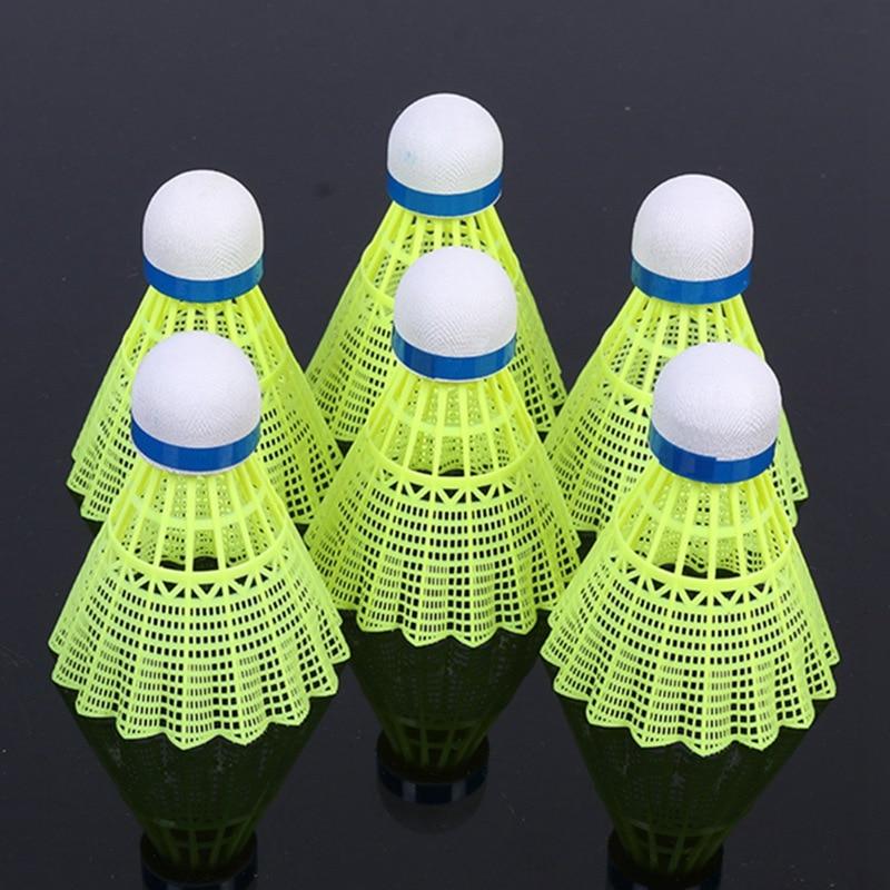 6 uds súper duradero/Nylon ligero pelota de entrenamiento pelota de Badminton plástico lanzadera corcho madera cabeza de bola TX005