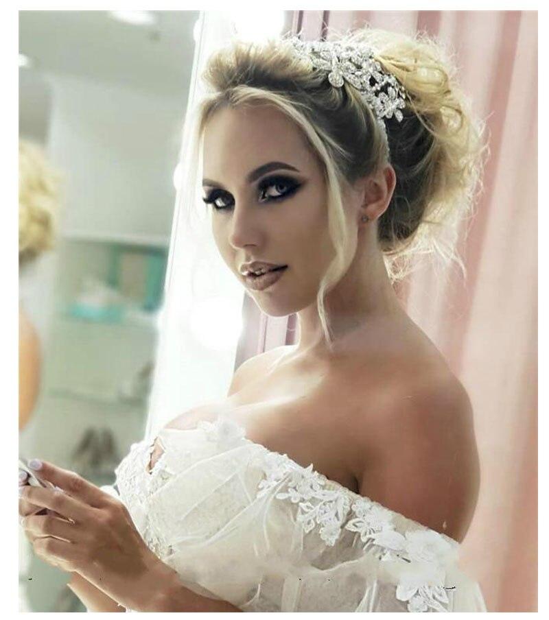 Купить с кэшбэком LORIE Princess Wedding Dress Sweetheart Appliqued 3D Flowers Bride Dress  Tulle Backless Boho Wedding Dress Ball Gowns