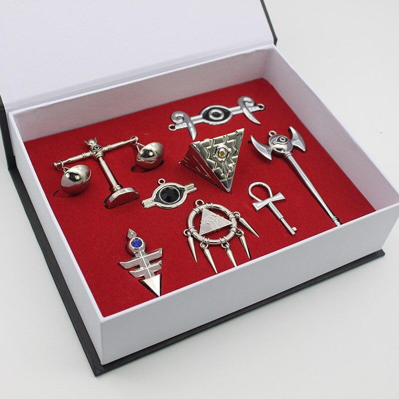 ¡24 caja/lote YuGiOh Concha collar de colgantes de Yu-Gi-Oh! Del Milenio emperador triángulo de llaveros de logotipo venta al por mayor envío gratis por DHL