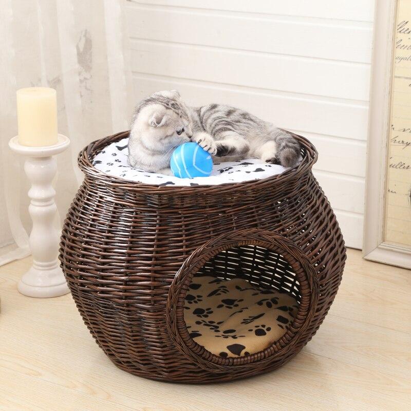 Un manual de ratán Casa de gato tejido de mimbre Natural gato nido accesorios de gato verde duradero con alfombra gruesa para mascota grande