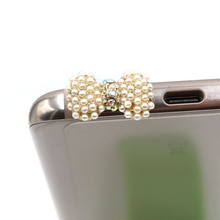 Élégance mode Style petite perle avec diamant arc Design téléphone portable bouchon doreille bouchon anti-poussière pour Iphone Samsung 3.5 mmdust Plug