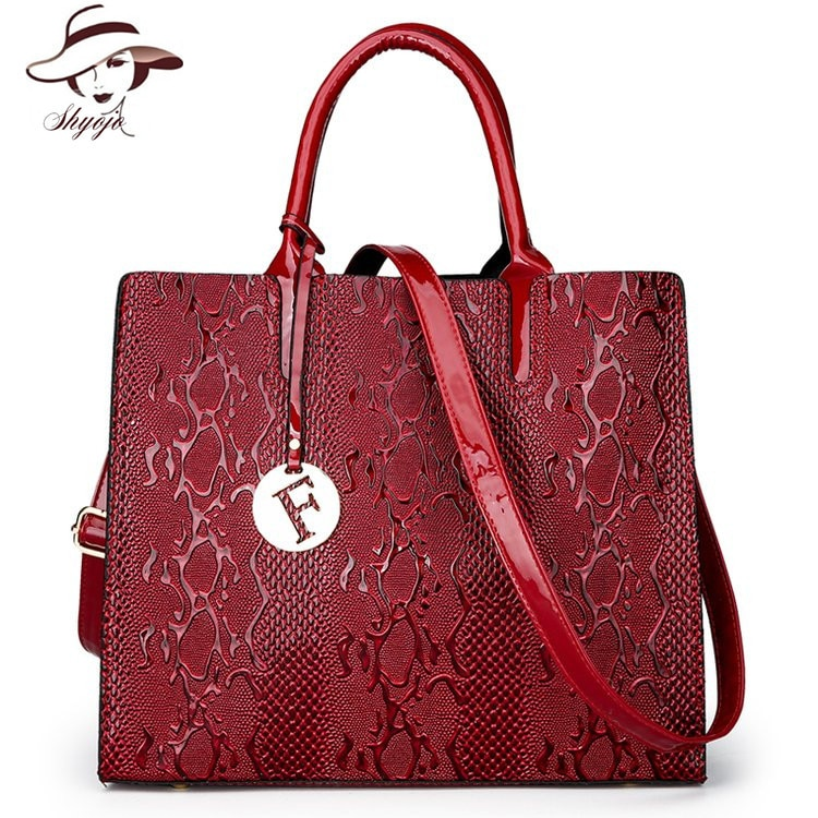 Alta calidad 2020 primavera nueva marca de lujo de moda charol mujeres bolsos de hombro mujer serpiente diseñador bolsos de mano señoras Tote
