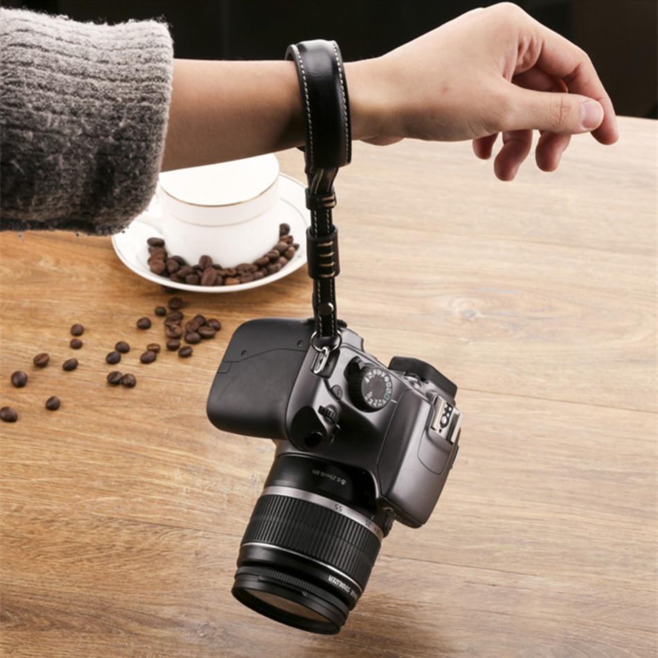 Correa de mano de cuero PU para Canon Nikon j1 j2 v1 v2 Sony nex7 nex5 nex3 a7 Leica Panasonic Sumsang DC SLR Cámara