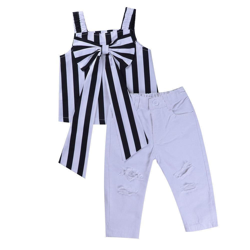 Оптовая продажа, детский Модный Полосатый Топ с бантом в европейском и американском стиле + разбитые брюки, комплект одежды для девочек