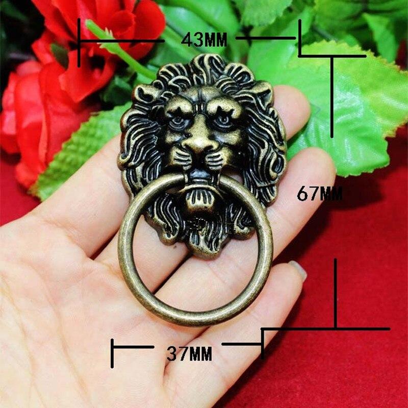 Venta al por mayor, tirador de puerta de muebles con cabeza de león Vintage, tiradores de armario de aleación de Zinc para cajones, 43x67mm, 30 Uds