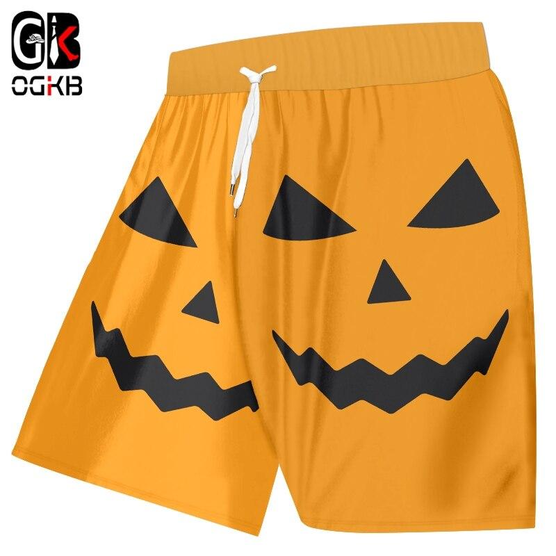 OGKB Hombre Nuevo Halloween amarillo encantador 3D impreso divertido cara humana calabaza patrón al por mayor ocio hombres playa pantalones cortos
