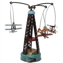 Liquidation jouet rotatif avion carrousel horloge jouets en étain, jouet Vintage drôle pour enfants/cadeau adulte