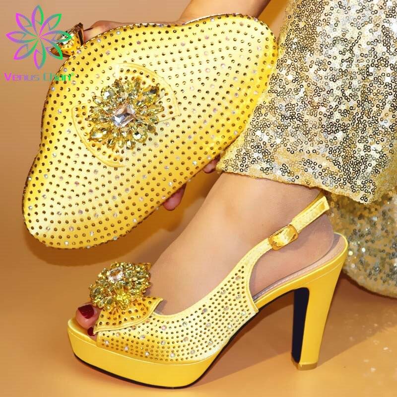 Zapatos de fiesta de moda de Color dorado y bolsos de embrague para combinar con el conjunto de zapatillas africanas de tacones súper altos para fiesta de año nuevo