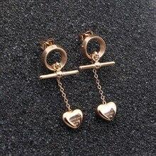 Nouveau anneau rond pêche coeur gland titane acier rose or boucles doreilles mode filles rose or pêche coeur boucles doreilles en gros