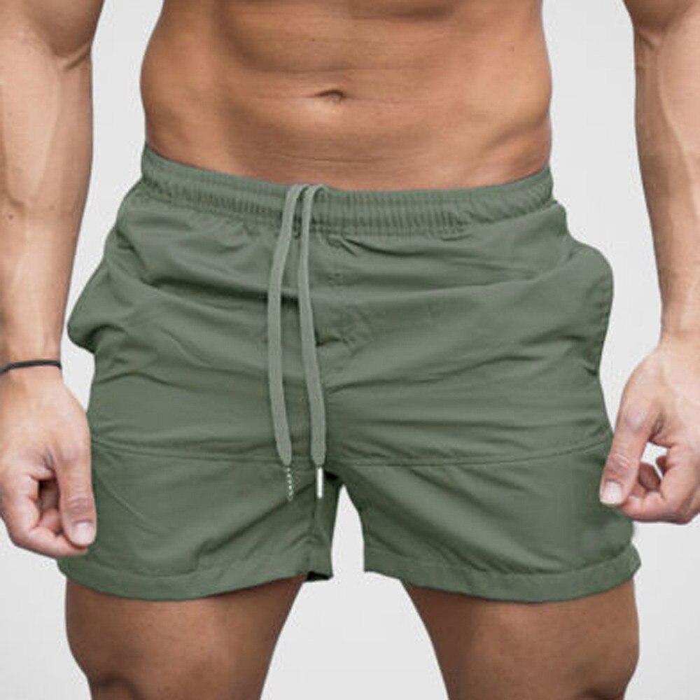 Calção masculina curta, cortos masculinos modernos, academia casual, esportes, corrida, elástica, cintura