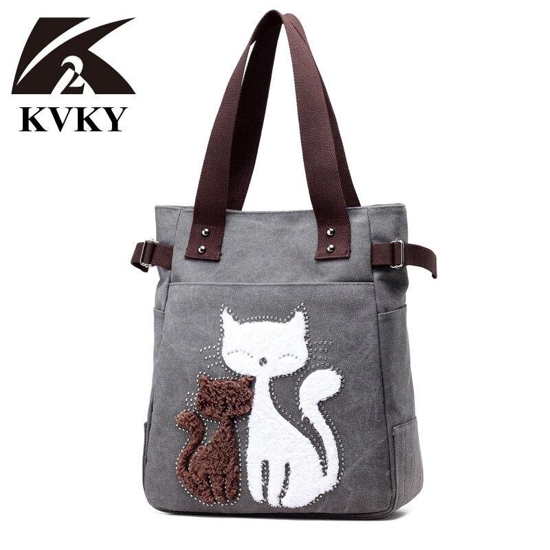 Lienzo de mujer KVKY bolso de marca famosa bolsos de hombro hembra bolsas de lona con Gato de felpa mono Appliques playa bolsa Sac principal
