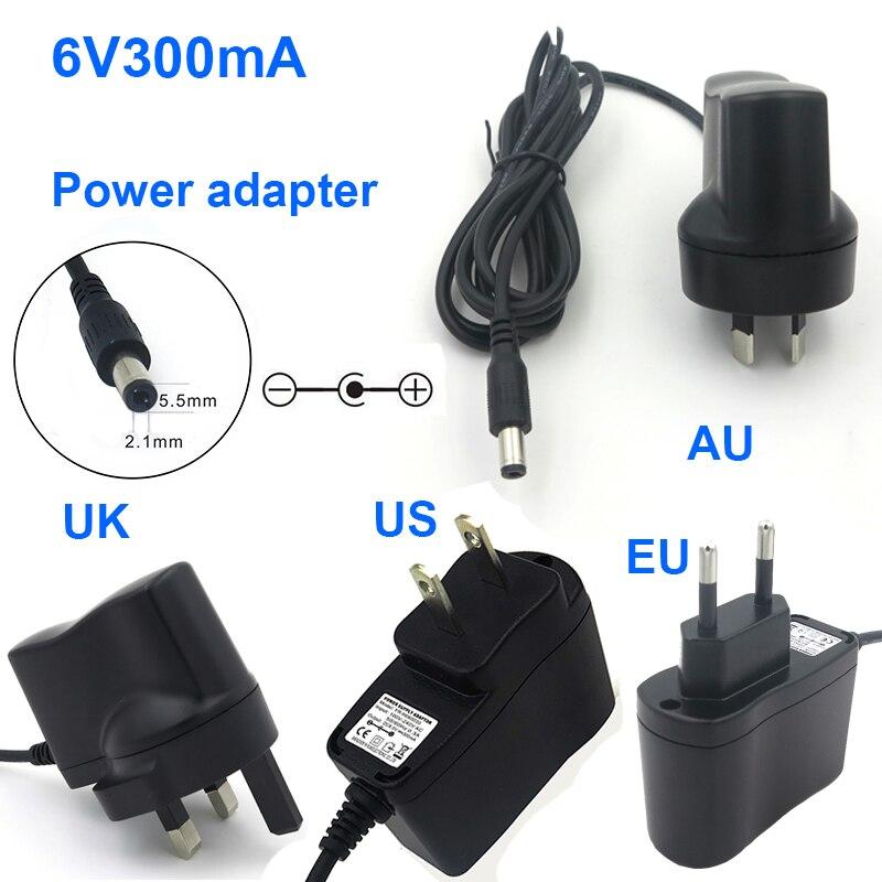 Schnelles Verschiffen 1PCS 6V 300mA AC/DC Power Adapter US/EU/UK/AU Stecker universal Ladegerät Converter 5.5*2,1mm für Walkie-talkie
