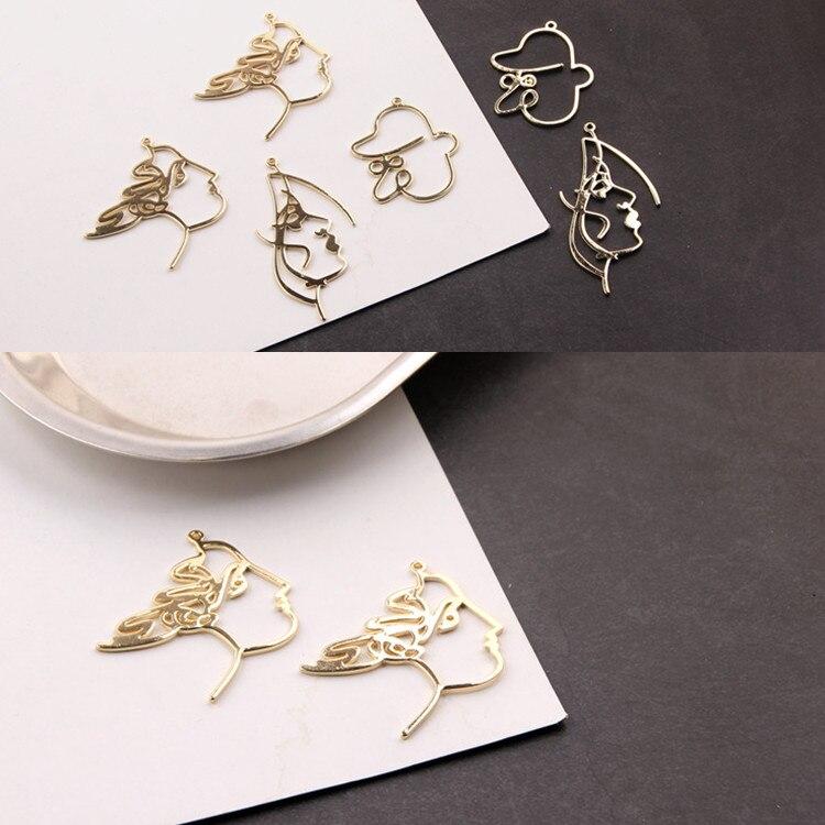 Delicado KC enchapado en oro cobre cara abstracta diseño de línea colgante pendiente collar Diy Material de joyería 4 Uds