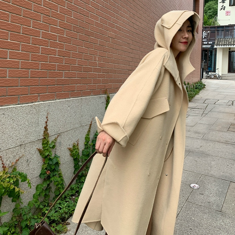 Hiver 2019 nouveau coréen Double face laine cousu à la main Long manteau de laine à capuche femmes Double boutonnage décontracté veste en laine ample