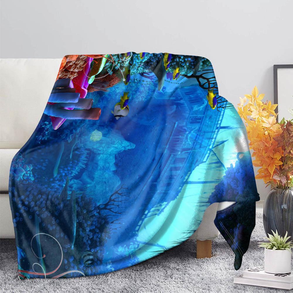 Manta colorida con diseño de tortuga delfín en el océano