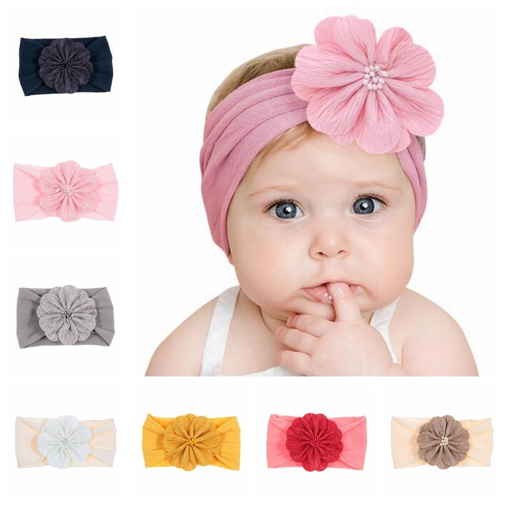 Nuevo 1 uds. Suave recién nacido niño flor sombreros lindos elásticos bebé niñas nudo Nylon turbante diadema accesorios de moda para el cabello