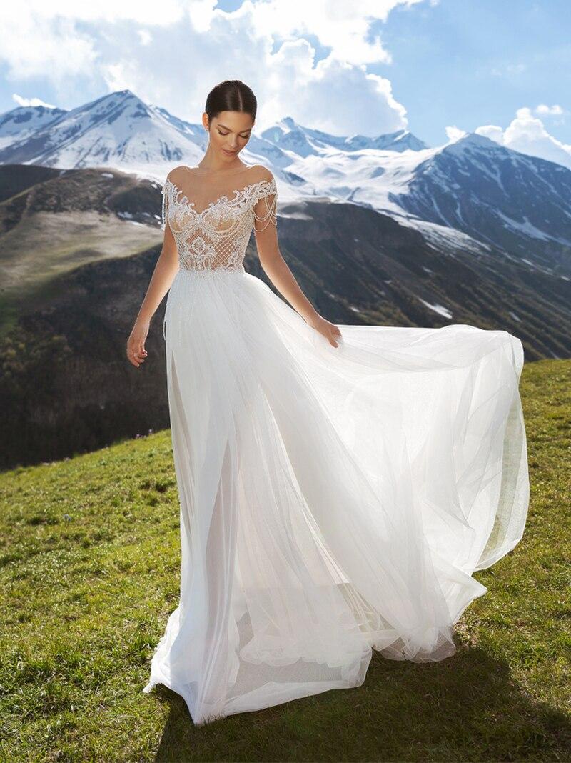 Promo 2021 Boho Beach Tulle Wedding Dress High Slit Transparent Lace Cap Sleeves Bead Tassels 2021 A Line Bateau Plus Size Bridal Gown