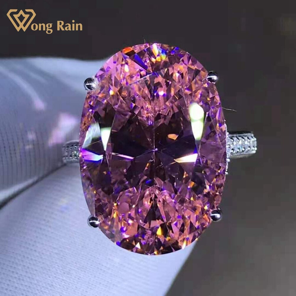 Review Wong Rain 925 Sterling Silver 15 CT Oval Cut Hyperbole Luxury Pink Created Moissanite Cocktail Ring Customized Ring Fine Jewelry