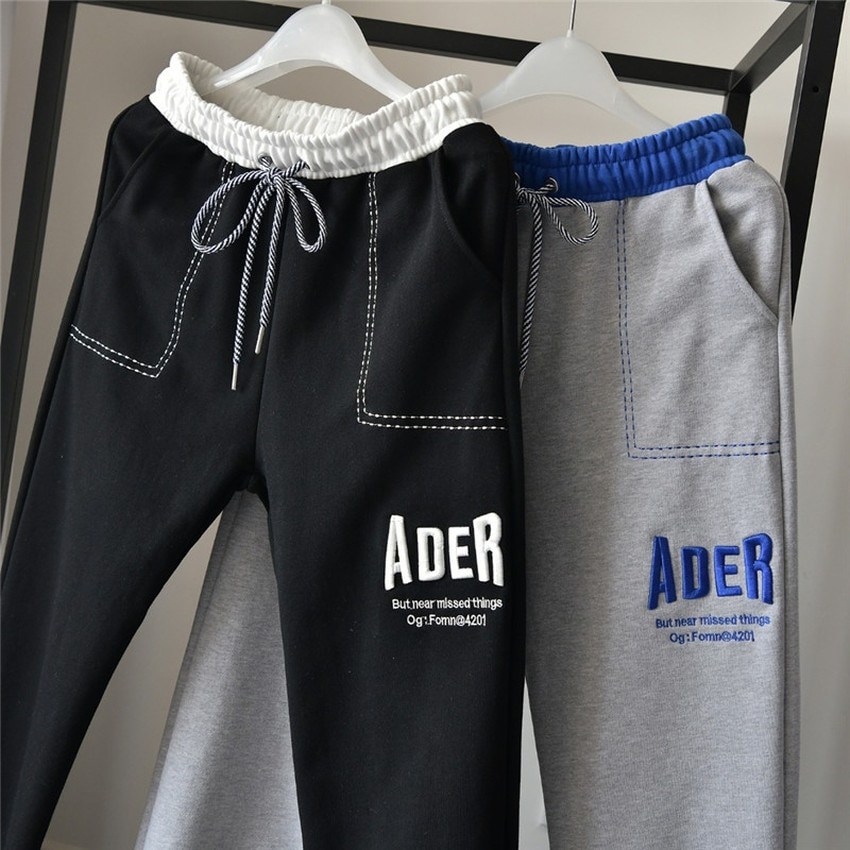 سروال خطأ من ADER مطرز بشعار على شكل حرف ADER سروال رياضي بأشرطة جانبية من وحش الثلج للرجال والنساء
