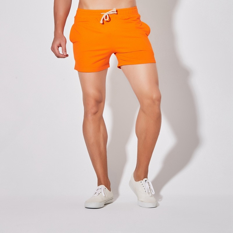Pantalones cortos de verano para hombre, pantalones cortos anaranjados de talla grande, ropa deportiva de algodón informal para hombre, pantalones cortos para correr de bádminton 4xl