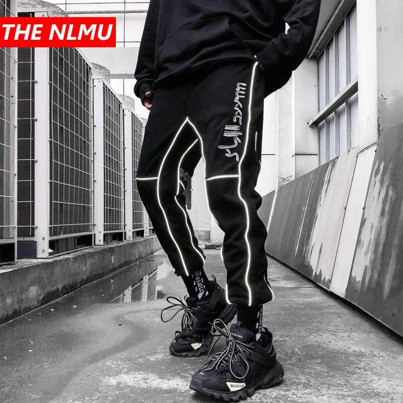 Hip diseño reflectante rayas Cargo pantalones hombres Joggers pantalón 2019 otoño Casual Streetwear pantalones cintura elástica negro WG558